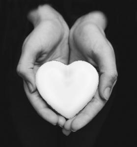 hands holding a white spirit heart