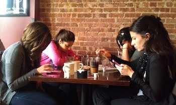 girls on cell phones at a restaraunt