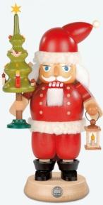 nutcracker-santa-holding-a-christmas-tree-and-light