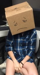 person with their head in a box.jpg